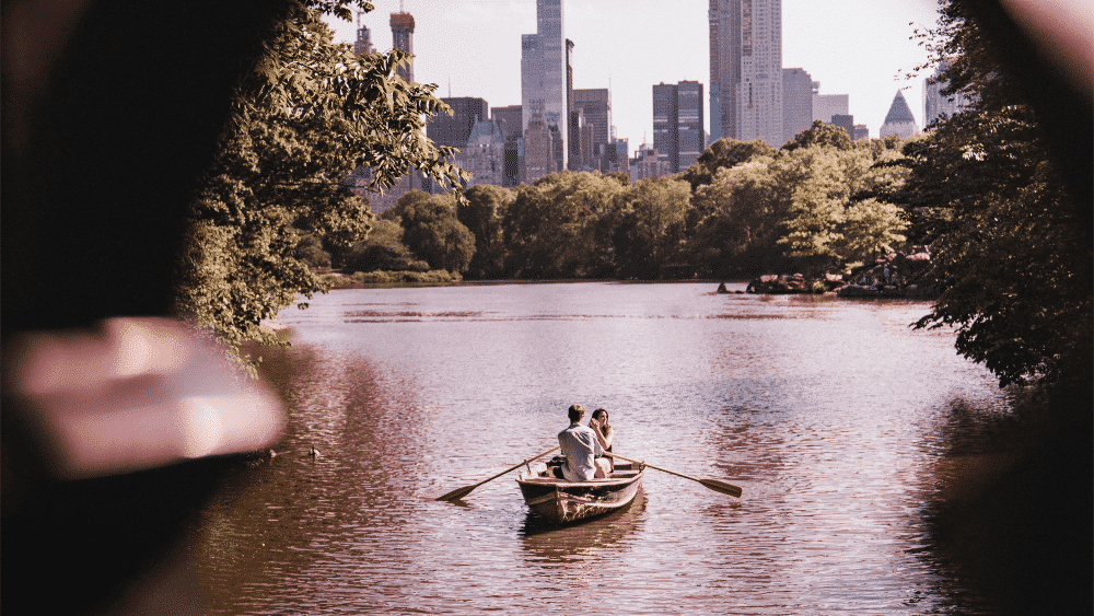 couple in central park on boat